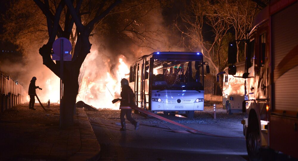 Firefighters try to extinguish flames following an explosion after an attack targeted a convoy of military service vehicles in Ankara