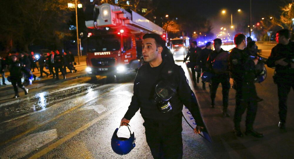 Cars of emergency services arrive after an explosion in Ankara, Turkey