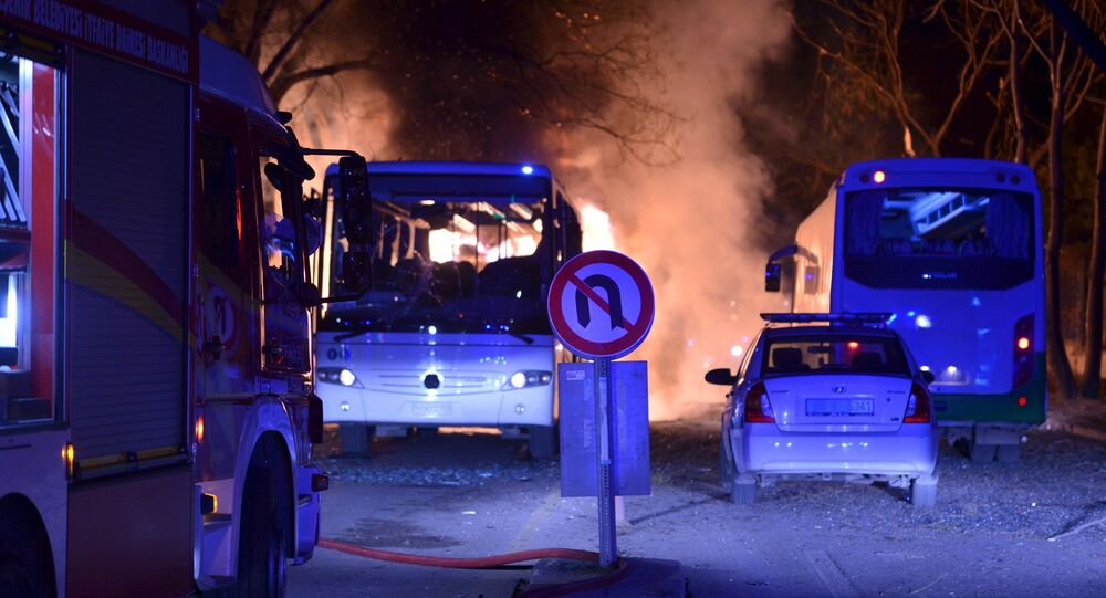 Cars of emergency services arrive after an explosion in Ankara, Turkey.