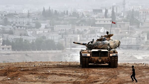Turkish soldiers on a tank sit opposite the Syrian town of Ain al-Arab, known as Kobane by the Kurds, at the Turkish-Syrian border in the southeastern Turkish village of Mursitpinar, Sanliurfa province (File) - Sputnik International