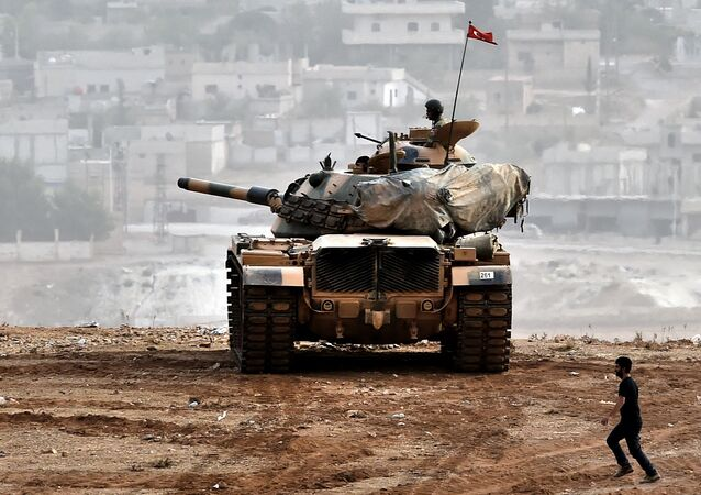 Turkish soldiers on a tank sit opposite the Syrian town of Ain al-Arab, known as Kobane by the Kurds, at the Turkish-Syrian border in the southeastern Turkish village of Mursitpinar, Sanliurfa province (File)