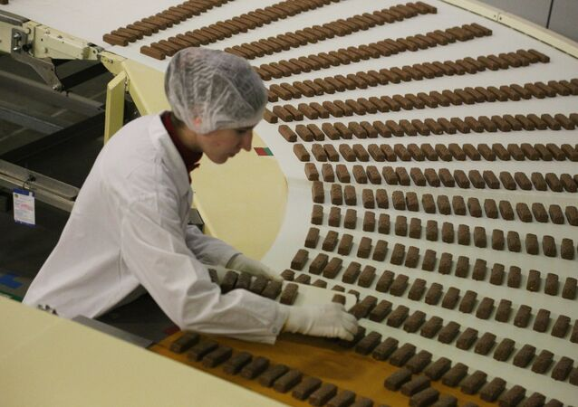An employee at work, at the chocolate factory