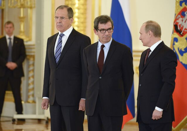 Russia's President Vladimir Putin (R), Russian Foreign Minister Sergei Lavrov (L) and new French ambassador to Russia, Jean-Maurice Ripert (C), attend a ceremony of receiving foreign ambassadors' credentials in Aleksandrovsky (Alexander's) Hall in Grand Kremlin Palace in Moscow, on January 16, 2014