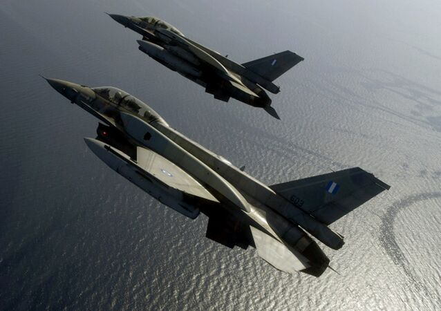 A handout photo by Hellenic Airforce shows two Greek F-16 fighters flying over the Aegean sea