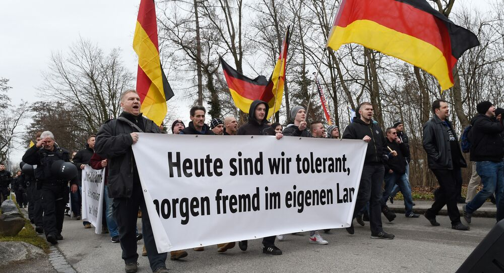 Protesters of the far right league We are the border (Wir sind die Grenze) carry a banner reading Today tolerant, tomorrow a stranger in his own country during a demonstration in Freilassing, southern Germany, on January 9, 2016.