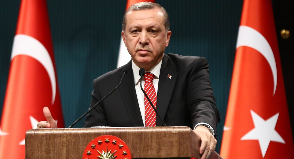 Turkish President Recep Tayyip Erdogan addresses a joint press conference with Yemen's president at the presidential complex in Ankara on February 16, 2016.
