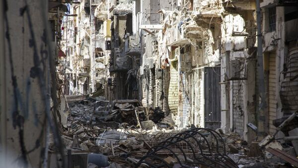 Street is filled with debris and abandoned houses in the city of Benghazi, Libya (File) - Sputnik International