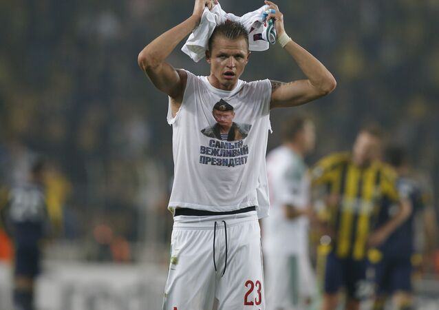 Locomotiv Moscow's Dmitri Tarasov features an inner shirt with a picture of Russian President Vladimir Putin and the slogan The most polite President, following a Europa League first leg round of 32, soccer match against Fenerbahce in Istanbul, Tuesday, Feb. 16, 2016
