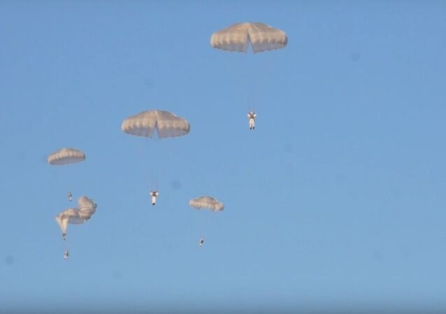 Russian Paratroopers, Vehicles Take Part in Massive Military Drills