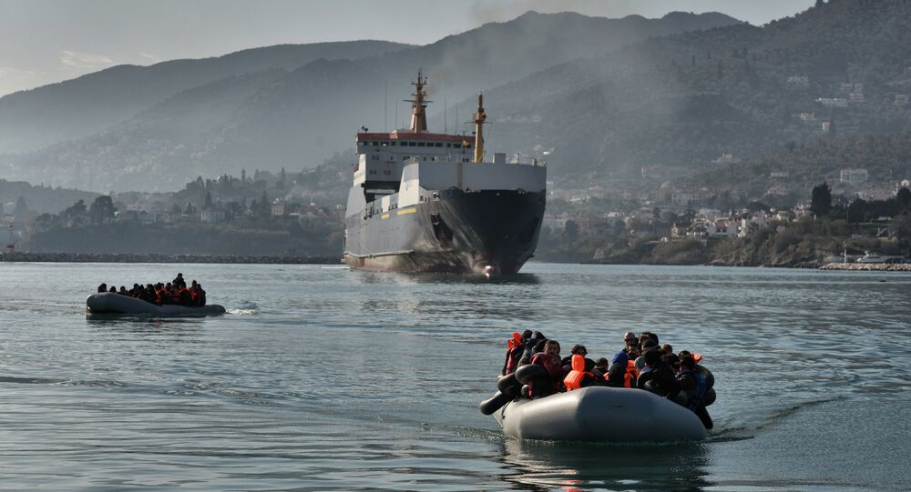 Refugees and migrants arrive on a dinghy at the port of Mytilene, on the Greek island of Lesbos, after crossing the Aegean sea from Turkey, on February 18, 2016