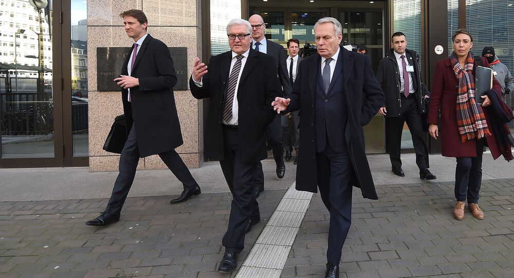 Germany's Foreign Minister Frank-Walter Steinmeier (2nd L) and France's Foreign Minister Jean-Marc Ayrault (3rd R) talk while leaving the European Council in Brussels after an EU foreign affairs council on February 15, 2016