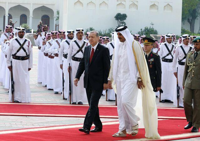 Turkey's President Recep Tayyip Erdogan, left, and Qatar's Emir Tamim bin Hamad Al Thani inspect a military honour guard during a ceremony in Doha, Qatar, Wednesday, Dec. 2, 2015