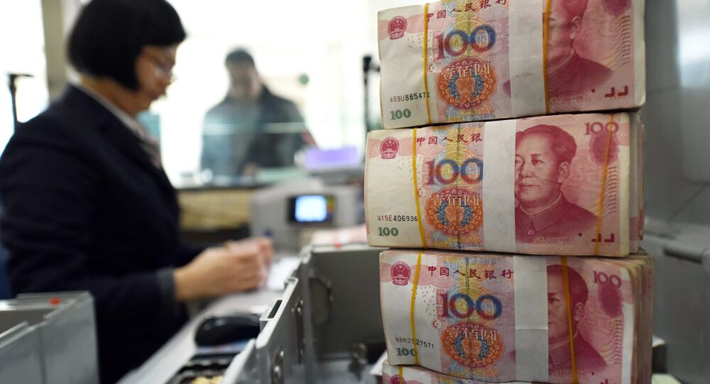 An employee counts 100-yuan (15 USD) banknotes at a bank in Lianyungang, in eastern China's Jiangsu province on January 7, 2016