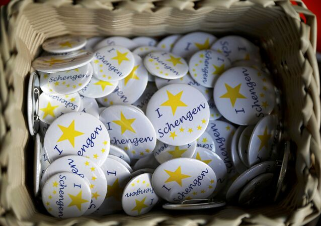 Badges with text 'I Love Schengen' are pictured at a store of the European museum of Schengen.