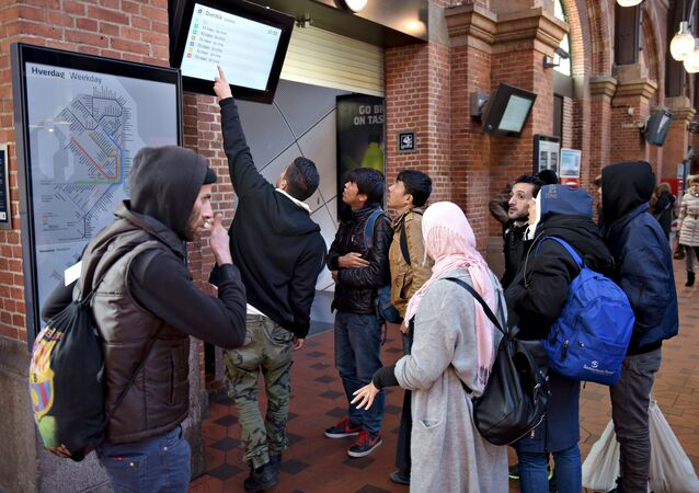 A group of migrants check a departure board at Copenhagen Central Station, Denmark, November 12, 2015 (photo used for illustration purpose)