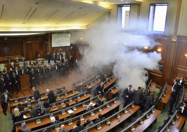 Opposition politicians release tear gas in parliament to obstruct a session in Pristina, Kosovo February 19, 2016