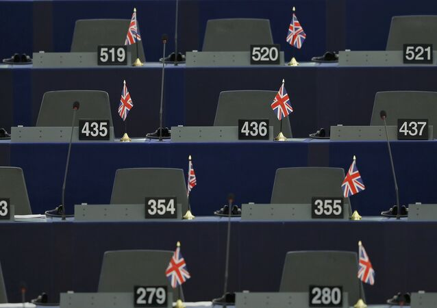 British Union Jack flags are seen on the desks of members of the European parliament ahead of a debate on the upcoming summit and EU referendum in the UK, in Strasbourg, France, February 3, 2016.