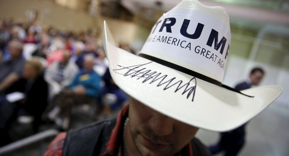A campaign volunteer for U.S. Republican presidential candidate Donald Trump wears a hat signed by Trump during a rally with supporters in Gaffney, South Carolina February 18, 2016