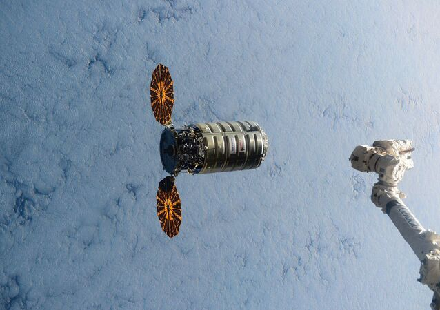 This image made available by NASA via Twitter shows the Cygnus spacecraft approaching the International Space Station on Wednesday, Dec. 9, 2015