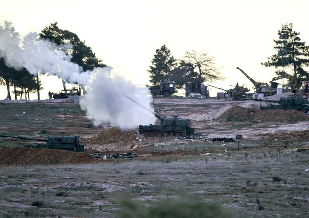 Tanks stationed at a Turkish army position near the Oncupinar crossing gate close to the town of Kilis, south central Turkey, fire towards the Syria border, on February 16, 2016