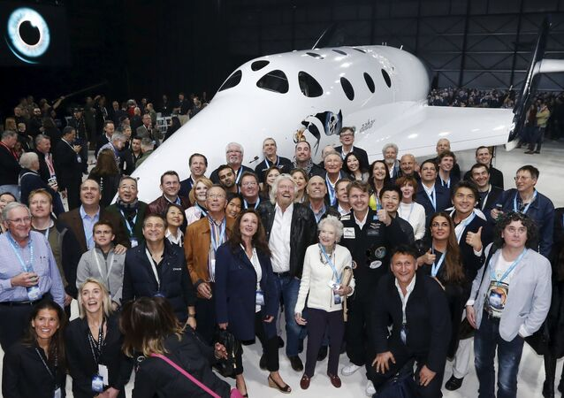 Sir Richard Branson (C) poses with his mother Eve (C-R) and future astronauts after unveiling the new SpaceShipTwo, a six-passenger two-pilot vehicle meant to ferry people into space that replaces a rocket destroyed during a test flight in October 2014, in Mojave, California, United States, February 19, 2016