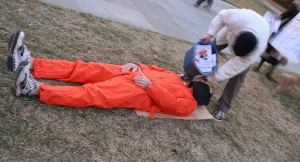 Students protest at a talk given by Karl Rove by demonstrating waterboarding at Duke University on December 4, 2007