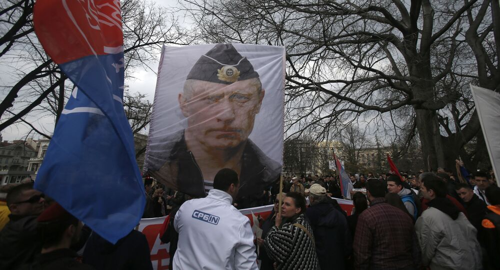 Protesters hold a picture of Russian President Vladimir Putin during a protest against NATO in downtown Belgrade, Serbia, Saturday, Feb. 20, 2016