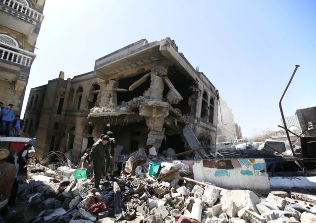 People inspect a house destroyed by Saudi-led airstrikes that killed a TV director, his wife, and three children in Sanaa, Yemen, Wednesday, Feb. 10, 2016