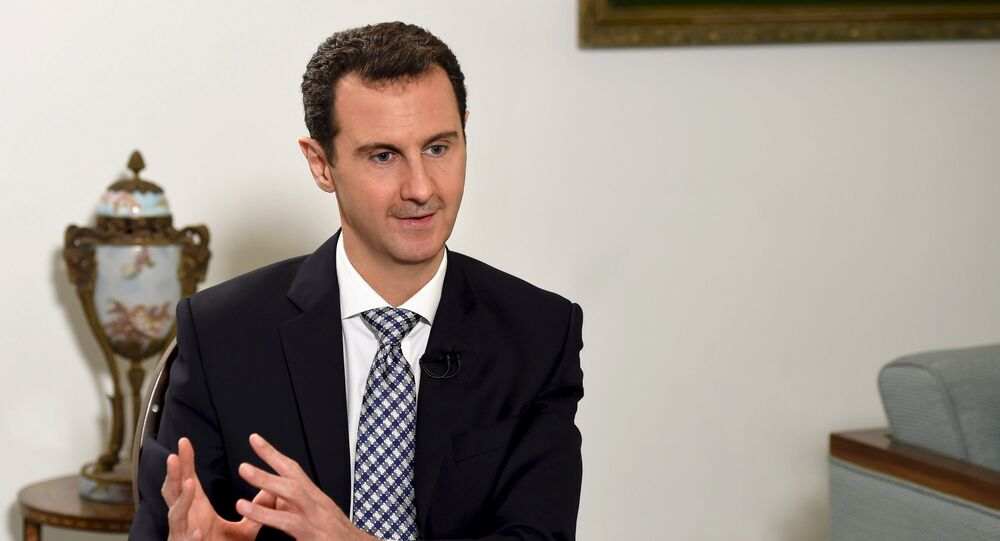 Syria's President Bashar al-Assad speaks during an interview with Spanish newspaper El Pais in Damascus, in this handout picture provided by SANA on February 20, 2016