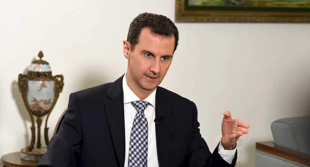 Syria's President Bashar al-Assad speaks during an interview with Spanish newspaper El Pais in Damascus, in this handout picture provided by SANA on February 20, 2016.