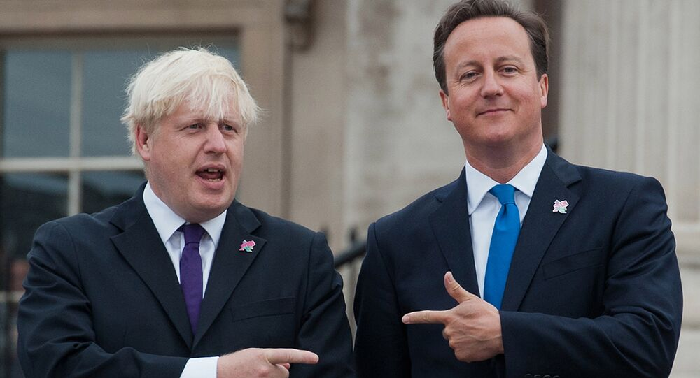 British Prime Minister David Cameron (R) and London Mayor Boris Johnson (L) pointing at each other on August 24, 2012.