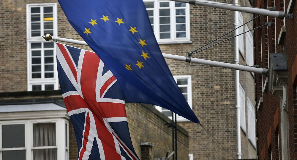 A EU flag hangs beside the Union Jack at the Europa House in London, Wednesday, Feb. 17, 2016.