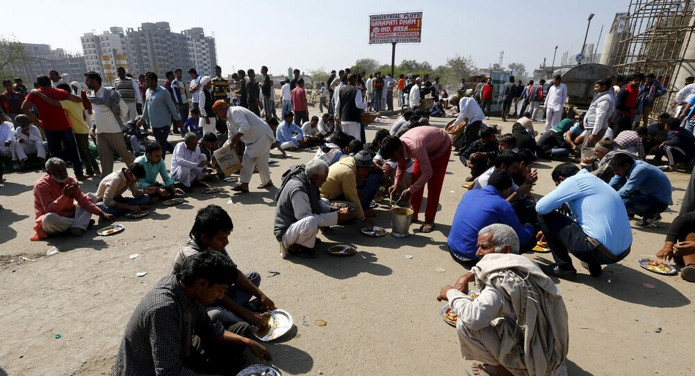 Demonstrators from the Jat community eat as they block the Delhi-Haryana national highway during a protest in New Delhi, India, February 21, 2016