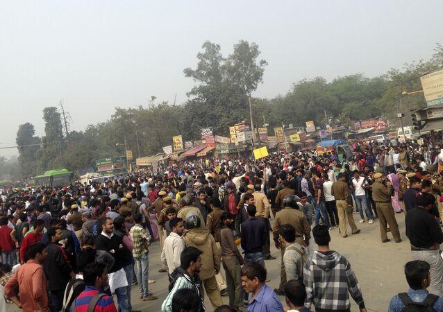 Protestors of the Jat agricultural community block a road near the Delhi University area in New Delhi, India, Saturday, Feb.20, 2016.