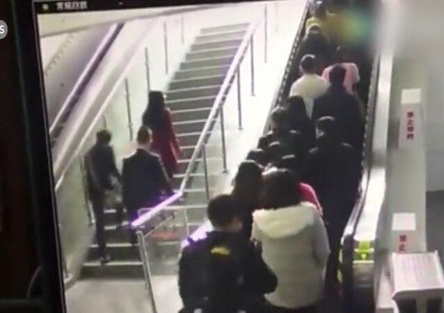 An escalator drops people