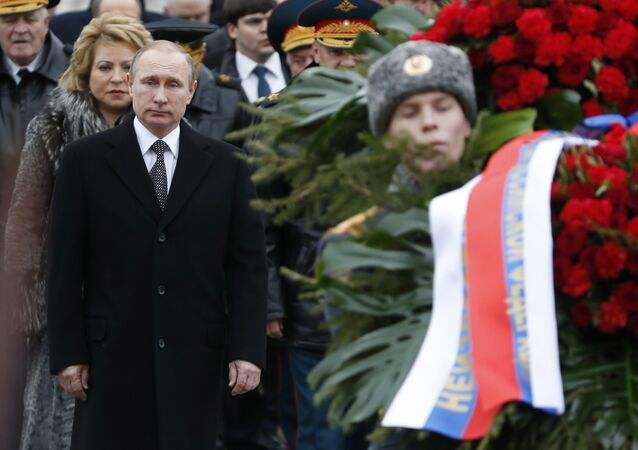 Russian President Vladimir Putin (L, front) attends a wreath laying ceremony to mark the Defender of the Fatherland Day at the Tomb of the Unknown Soldier by the Kremlin wall in central Moscow, Russia, February 23, 2016.