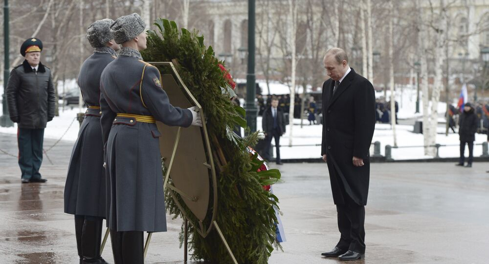 February 23, 2016. President Vladimir Putin, right, during the wreath-laying ceremony at the Tomb of the Unknown Soldier on the Defender of the Fatherland Day.