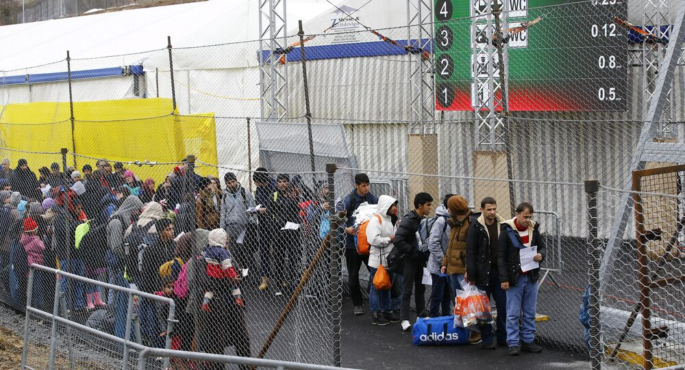 Migrants wait to cross the border from Slovenia into Spielfeld in Austria, in this February 16, 2016 file photo.