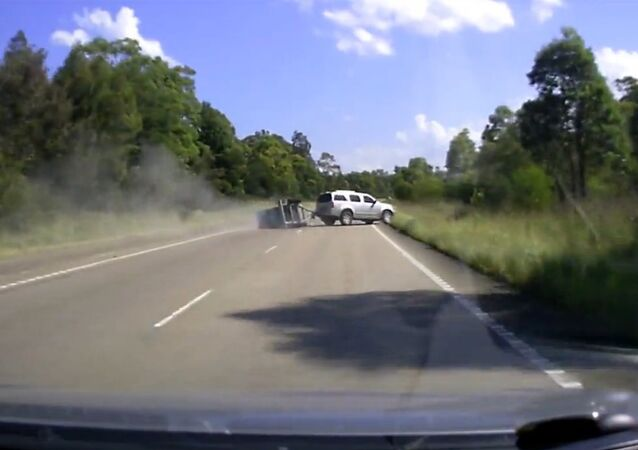 Trailer causes SUV to flip