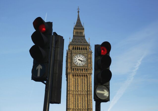 Red traffic lights stop traffic in front of the Big Ben bell tower at the Houses of Parliament in London, Britain February 22, 2016.