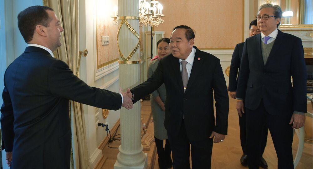Russian Prime Minister Dmitry Medvedev, left, greets Thailand's Defense Minister Prawit Wongsuwon and Thailand's Deputy Prime Minister Somkit Chatusriphithak, right, during their meeting in Moscow, Russia