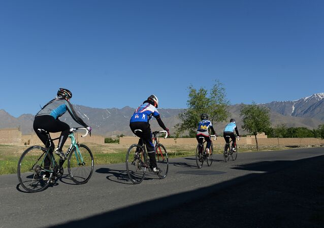 Members of the Afghan national women's cycling team riding their road bikes in Paghman district of Kabul province.