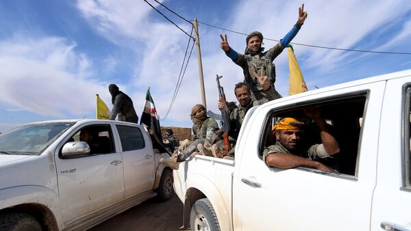 Syria Democratic Forces and Free Syrian Army fighters gesture on the back of pick-up trucks in a village on the outskirts of al-Shadadi town, Hasaka countryside, Syria - Sputnik International