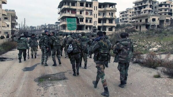 In this photo released on Tuesday, Jan 12, 2016, by the Syrian official news agency SANA, shows Syrian government troops and allied militiamen walk inside the key town of Salma in Latakia province, Syria - Sputnik International