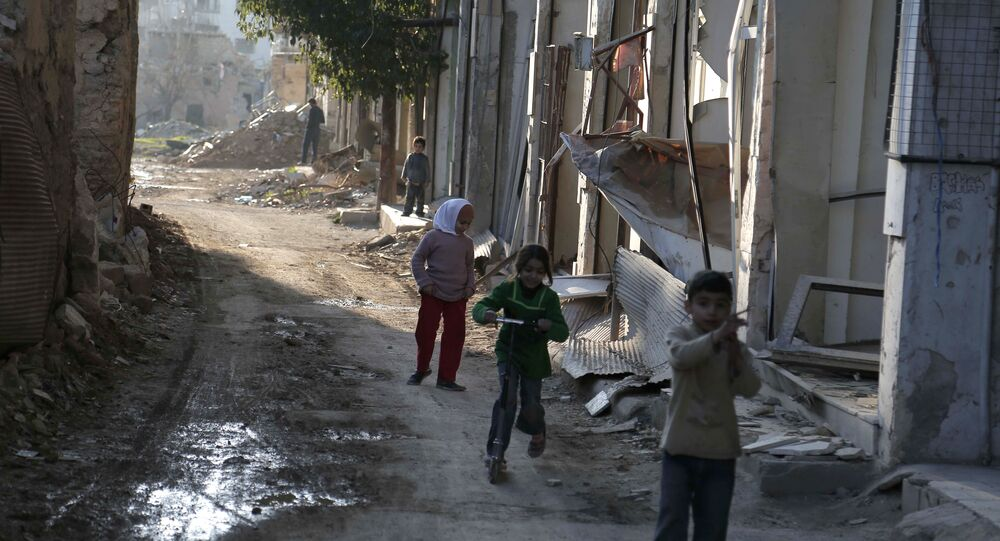Syrian children play between buildings destroyed by shelling in the neighbourhood of Jobar, on the eastern outskirts of the capital Damascus, on February 24, 2016