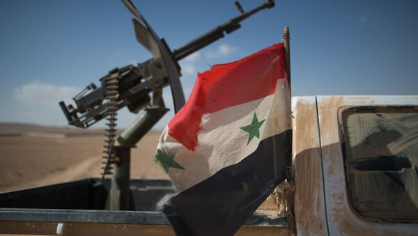 A Syrian flag on a truck with a machine gun of the Syrian Arab Army (SAA) near the town of Mhin, Syria - Sputnik International