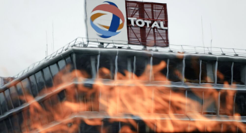 View taken of fire lit by employees of French oil giant Total (File)