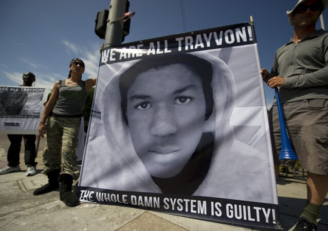 Americans angry at the acquittal of George Zimmerman in the death of black teen Trayvon Martin protest in Los Angeles, California July 14, 2013