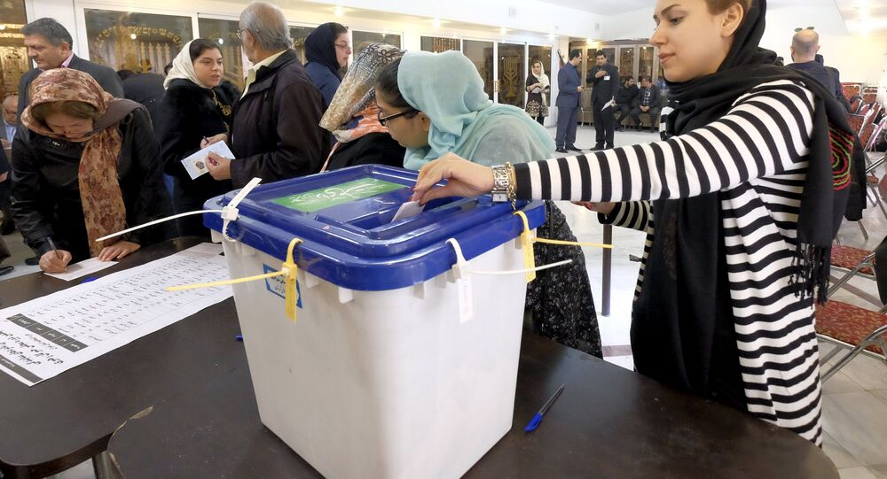 Iranian Jewish woman casts her ballot at a synagogue, used as a polling station, during elections for the parliament and Assembly of Experts, in Tehran.