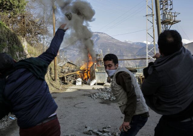Turkish people clash with riot police during a protest against mine project on February 17, 2016, in northern Turkish city of Artvin